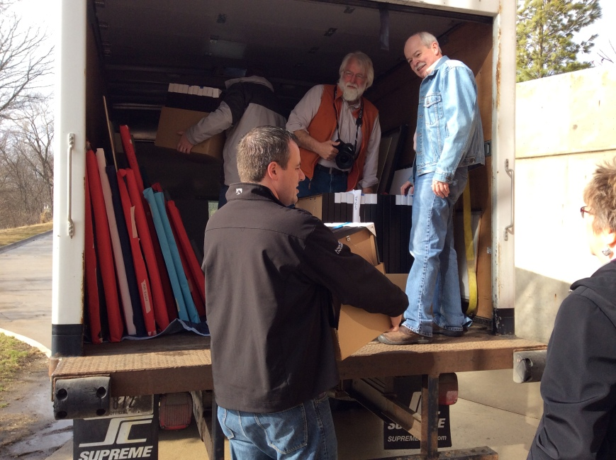 Only Jim Heemstra would help load a truck with a camera around his neck.
