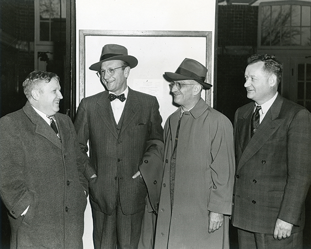 "Harley Wilhelm led the team that supplied the Manhattan Project with solid ""biscuits"" of uranium. Pictured in 1948 are Frank Spedding, David Lilienthan, W.A. Waymack, and Harley Wilhelm."