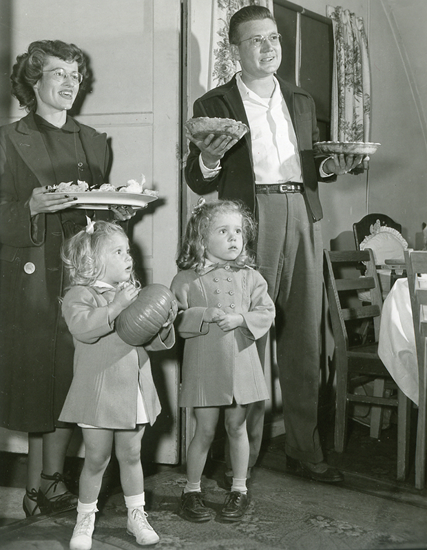 Cooperative spirit was ever-present in the years right after the war. Here, Elizabeth and Harry Tullis and their daughters Suzanne and Patsy arrive with their portion of a cooperative Thanksgiving dinner with friends in their Pammel Court unit in 1948.