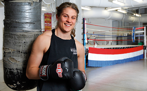 Iowa State University boxer Olivia Meyer of Dyersville is the first ISU female boxer to compete and win a title in the National Collegiate Boxing Association National Championships. (Photo by Christopher Gannon)